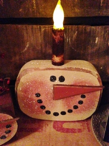 chunky snowman with candle