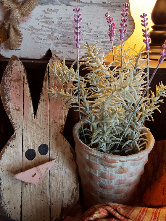 wooden rabbit and rosemary