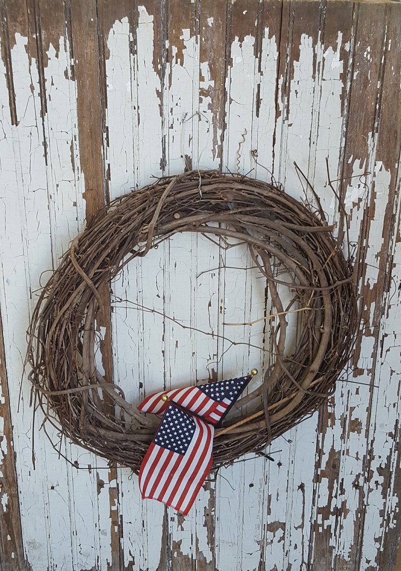 old white chippy door with grapevine wreath